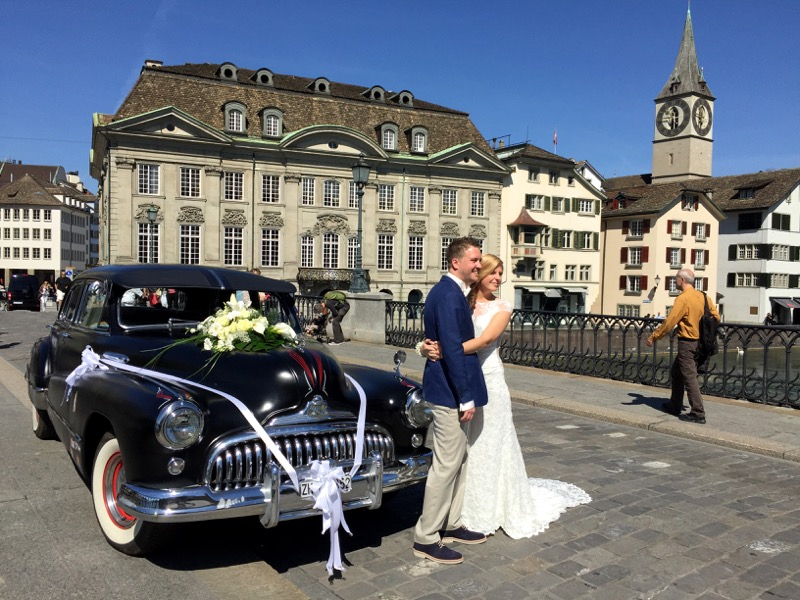 Back on the ground, a just married couple poses on the bridge with '48 Buick.