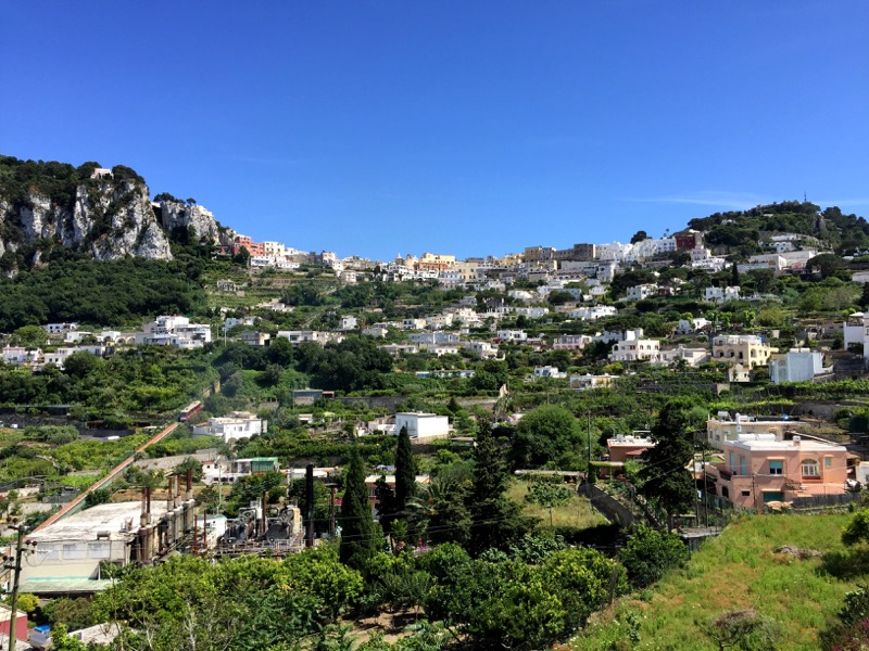 The view up the hill to Capri Town from our Airbnb; the funicular can be see on the track on the left.