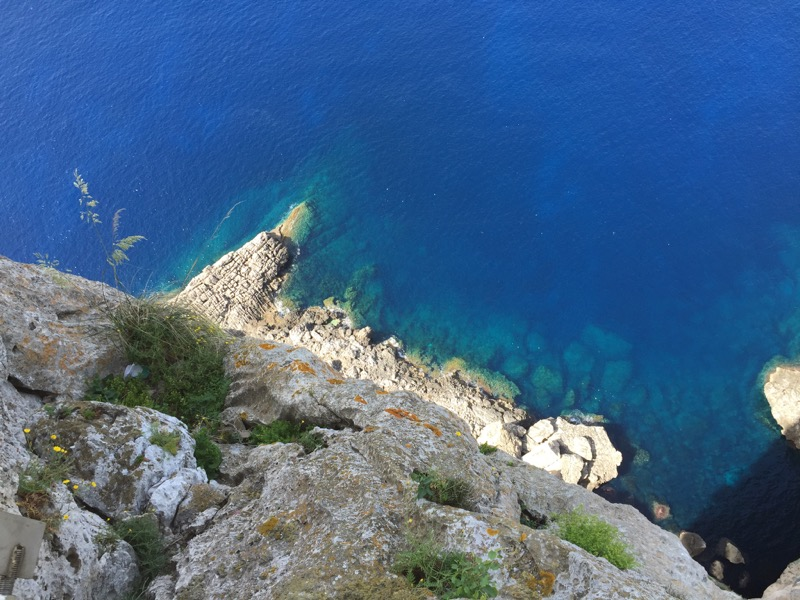 Looking straight down from a cliff into the Mediterranean